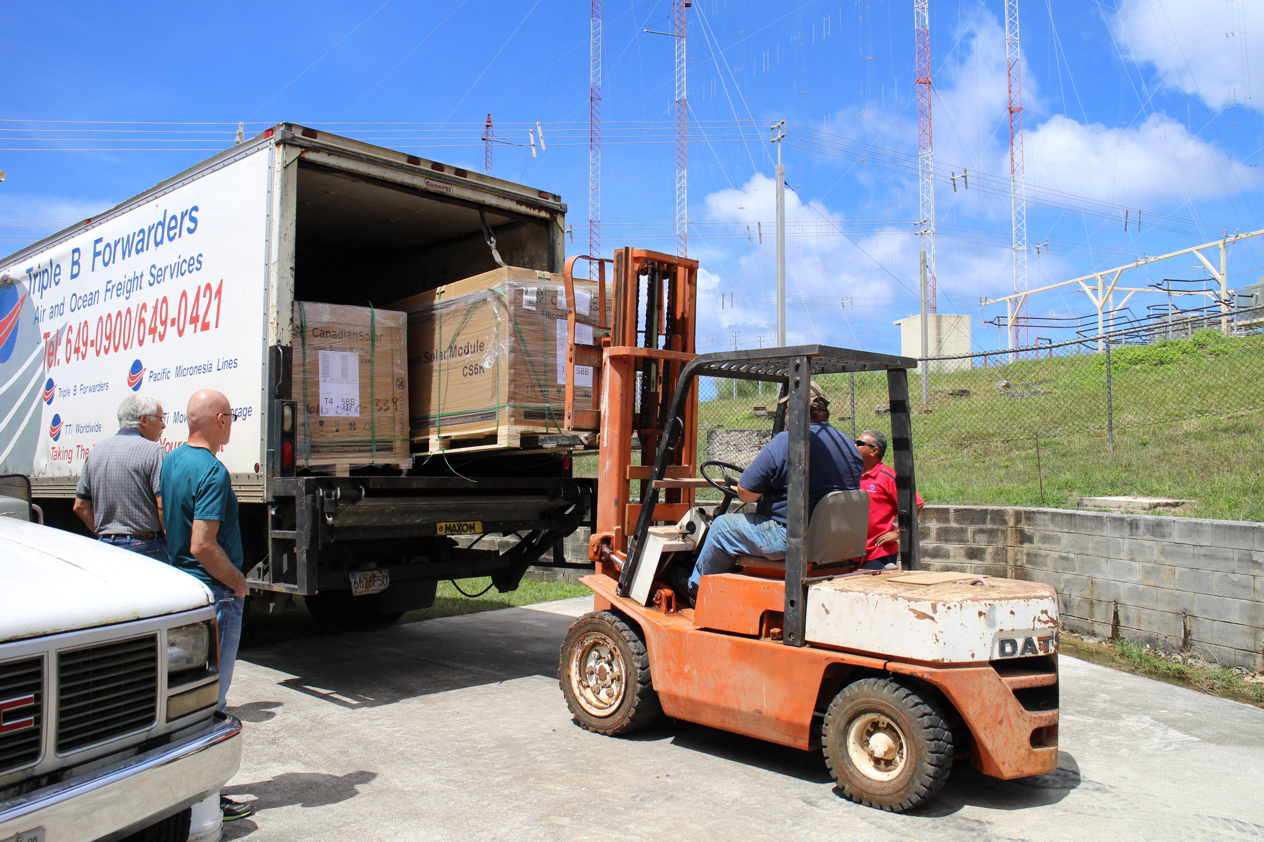 The Guam team unloads more solar panels to complete phase 3 of the project.