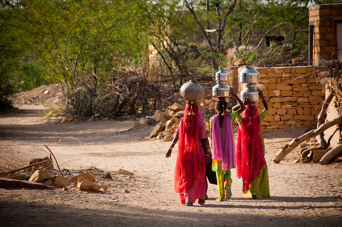 iStock-121897684-India-village-women-walking-with-wate-containers